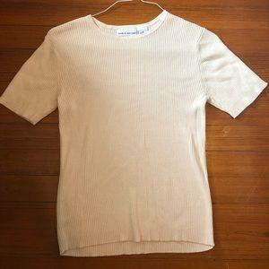 Classic, cream-colored, cotton knit blouse
